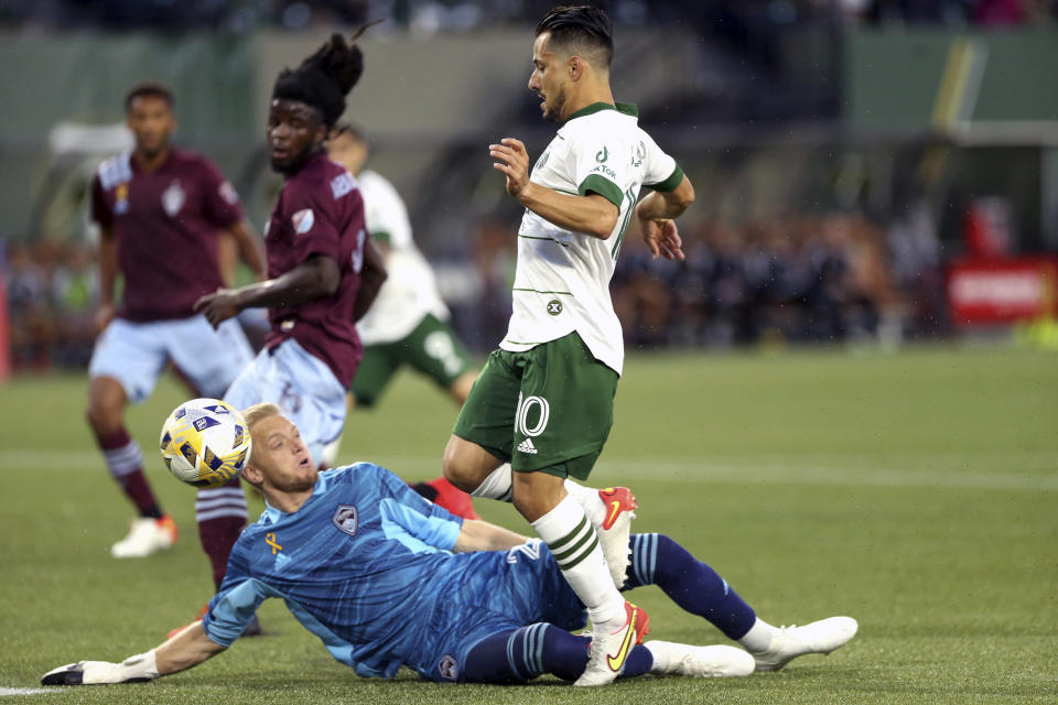 Timbers midfielder Sebastian Blanco (10) has his shot blocked by Colorado Rapids goalkeeper William Yarbrough during an MLS soccer match Wednesday, Sept. 15, 2021, in Portland, Ore. (Sean Meagher/The Oregonian via AP)