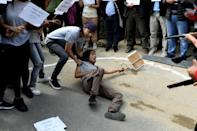 Activists stage a street play while taking part in a demonstration against the military coup in front of Myanmar's embassy in Kathmandu