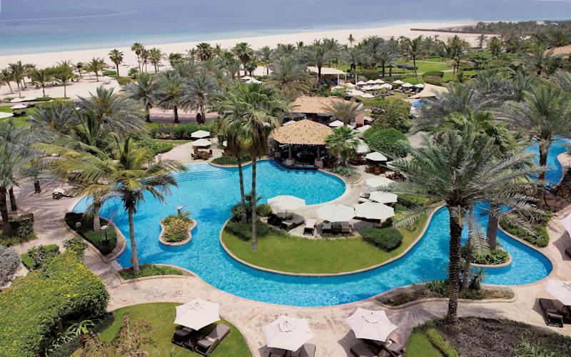 A multitude of swimming pools, such as the ones at the Ritz-Carlton, add to the family-friendly offerings at hotels in Dubai