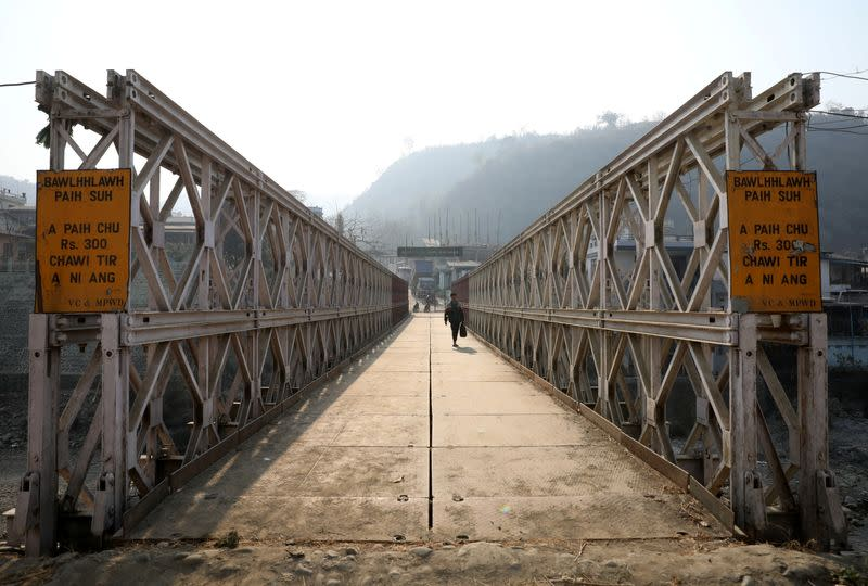 A person walks on a bridge that connects Myanmar and India at the border village of Zokhawthar