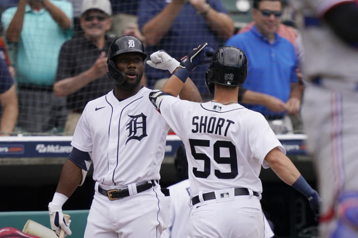 Detroit Tigerss' Zack Short is greeted b Akil Baddoo after a solo home run during the fourth inning of a baseball game against the Texas Rangers, Thursday, July 22, 2021, in Detroit. (AP Photo/Carlos Osorio)
