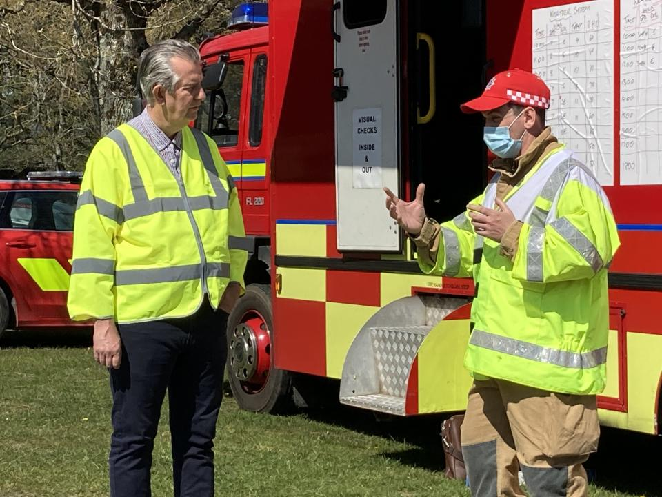 Environment Minister Edwin Poots meets firefighters tackling a major blaze at the Mourne Mountains (Rebecca Black/PA)
