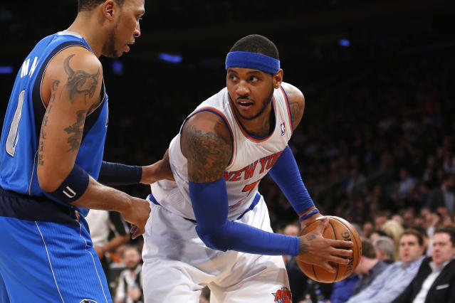 New York Knicks' Carmelo Anthony, right, works against Dallas Mavericks' Shawn Marion during the first half of an NBA basketball game Monday, Feb. 24, 2014, in New York. Dallas won 110-108. (AP Photo/Jason DeCrow)