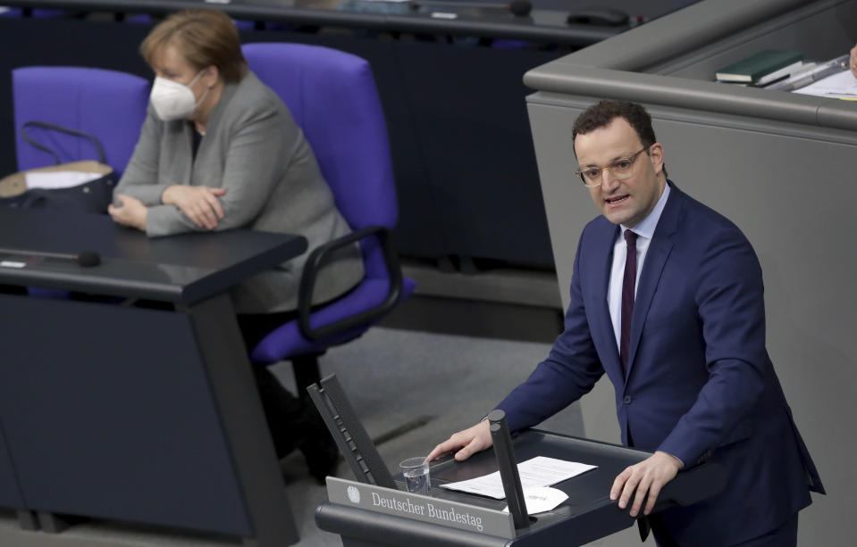 File - In this Wednesday, Jan. 13, 2021 file photo German Chancellor Angela Merkel listen to German Health Minister Jens Spahn holding a speech on the current developments of the new coronavirus pandemic in Germany at a meeting of the parliament, Bundestag, in Berlin, Germany.German Chancellor Angela Merkel's center-right party, the Christian Democratic Union, CDU, is choosing a new leader on the weekend Saturday Jan. 16 and Sunday Jan. 17, 2021, a decision that will help determine who succeeds Merkel at the helm of the European Union's biggest economy after a 16-year reign. (AP Photo/Michael Sohn, file)