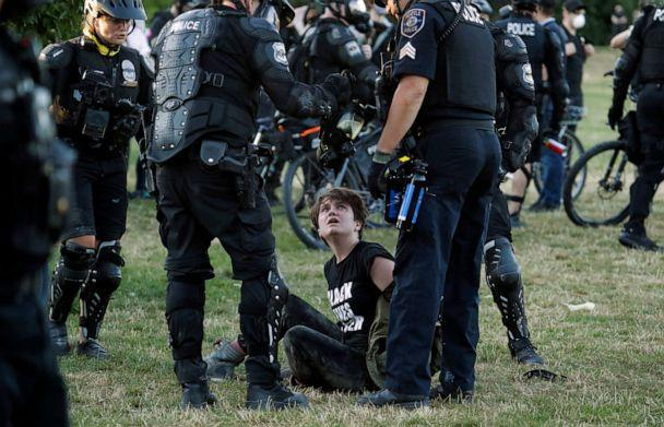 PHOTO: A person is arrested by Seattle Police at Cal Anderson Park, July 25, 2020, during a Black Lives Matter protest near the Seattle Police East Precinct headquarters. (Ted S. Warren/AP)