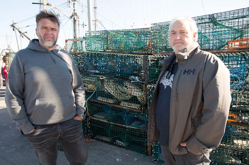 Colin Sproul, President of the Bay of Fundy Inshore Fishermen's Association, left, and Bernie Berry, President of the Cold Water Lobster Coalition, posed in front of Mi'kmaw lobster traps they seized in Saulnierville, N.S. on Sept. 20, 2020. (Photo: Mark O'Neill/The Canadian Press)
