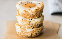 """<p>These protein-packed breakfast cups are seasoned with a spicy, smoky chipotle powder. The grated sweet potato and cheese holds everything in place, making these a terrific bite-sized option for breakfast. </p> <p><a href=""""https://www.thedailymeal.com/recipes/chipotle-sweet-potato-breakfast-egg-cups?referrer=yahoo&category=beauty_food&include_utm=1&utm_medium=referral&utm_source=yahoo&utm_campaign=feed"""" rel=""""nofollow noopener"""" target=""""_blank"""" data-ylk=""""slk:For the Chipotle Sweet Potato Breakfast Egg Cups recipe, click here."""" class=""""link rapid-noclick-resp"""">For the Chipotle Sweet Potato Breakfast Egg Cups recipe, click here. </a></p>"""