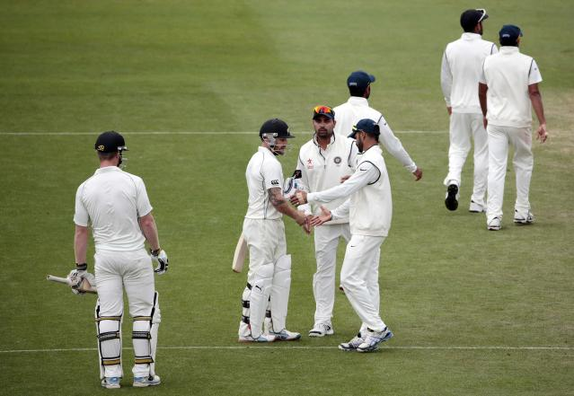New Zealand's Brendon McCullum is congratulated by India's players as he leaves the field out for 302 during the second innings of play on day five of the second international test cricket match at the Basin Reserve in Wellington, February 18, 2014. REUTERS/Anthony Phelps (NEW ZEALAND - Tags: SPORT CRICKET)