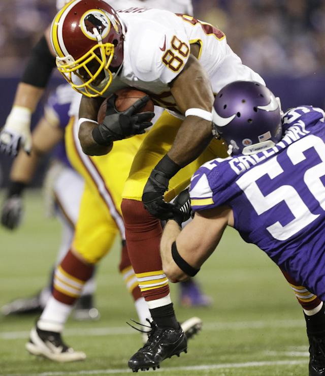 Washington Redskins wide receiver Pierre Garcon (88) tries to break a tackle by Minnesota Vikings outside linebacker Chad Greenway, right, after making a reception during the first half of an NFL football game Thursday, Nov. 7, 2013, in Minneapolis. (AP Photo/Jim Mone)