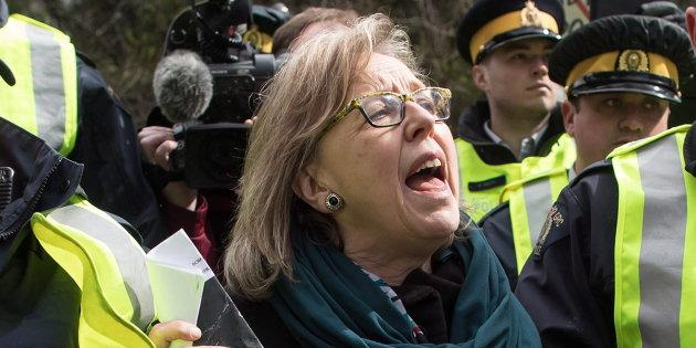 Green Party Leader Elizabeth May thanks supporters as she's arrested by RCMP officers after joining protesters outside Kinder Morgan's facility in Burnaby, B.C., on March 23, 2018.