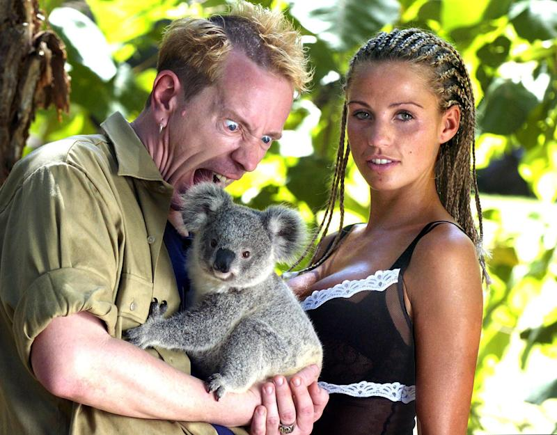 "British celebrities model Katie Price aka Jordan, right, and Johnny ""Rotten"" Lydon of the Sex Pistols get acquainted with a Koala at a wildlife park on the Gold Coast, Australia, Sunday, Jan. 25, 2004. The pair are competing with eight other celebrities in the British television program ""I'm a Celebrity ... Get Me Out Of Here ! "" which begins today in the Australian jungle near Murwillumbah, 200 kilometers (124 miles) south of Brisbane on Australia's east coast. Each celebrity will be voted for by the British public with the winner announced in the final show on Feb. 9. (AP Photo/Brian Cassey)"