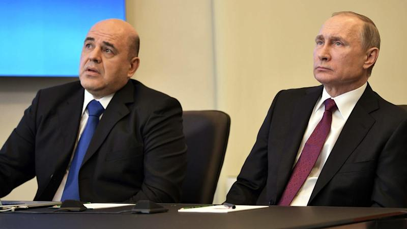 Head of Russia's Tax Service Mikhail Mishustin (L) has been named the country's new prime minister