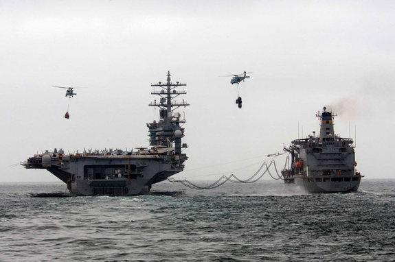 Aircraft carriers could carry 3D printers aboard to create replacement parts or drones on the go.