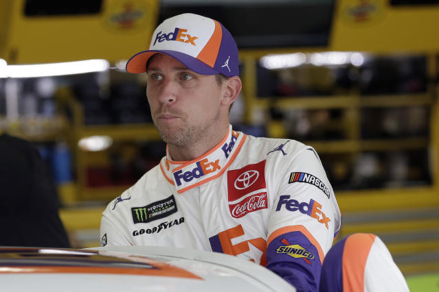 FILE - In this Sept. 28, 2019, file photo, Denny Hamlin climbs into is car to practice for the NASCAR Cup Series auto race at Charlotte Motor Speedway in Concord, N.C. Hamlin thought he was the favorite to win NASCAR's championship but now finds himself in danger of not even making it to the title round. Chase Elliott is fairly certain he's backed himself into such a hole that his only chance at a championship is by winning Sunday's penultimate race of the season. (AP Photo/Gerry Broome, File)