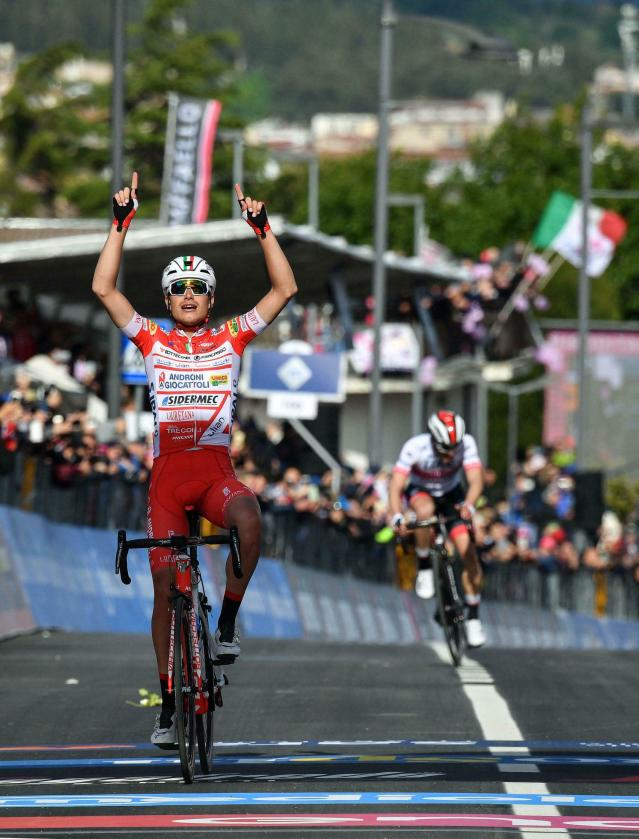 Italy's Fausto Masnada celebrates as he crosses the finish line to win the sixth stage of the Giro D'Italia, tour of Italy cycling race, from Cassino to San Giovanni Rotondo, Thursday, May 16, 2019. (Alessandro Di Meo/ANSA via AP)