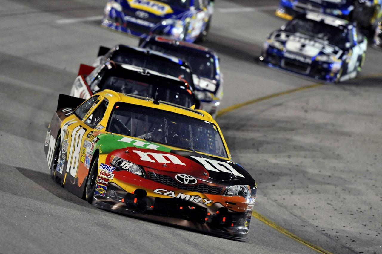 Kyle Busch leads the pack during the NASCAR Sprint Cup Series auto race at Richmond International Raceway, Saturday, April 28, 2012, in Richmond, Va. (AP Photo/Autostock, Nigel Kinrade) MANDATORY CREDIT