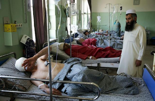 <p>Wounded men lie on their beds in Wazir Akbar Khan Hospital in Kabul, Afghanistan, Wednesday, May 31, 2017. (AP Photos/Massoud Hossaini) </p>