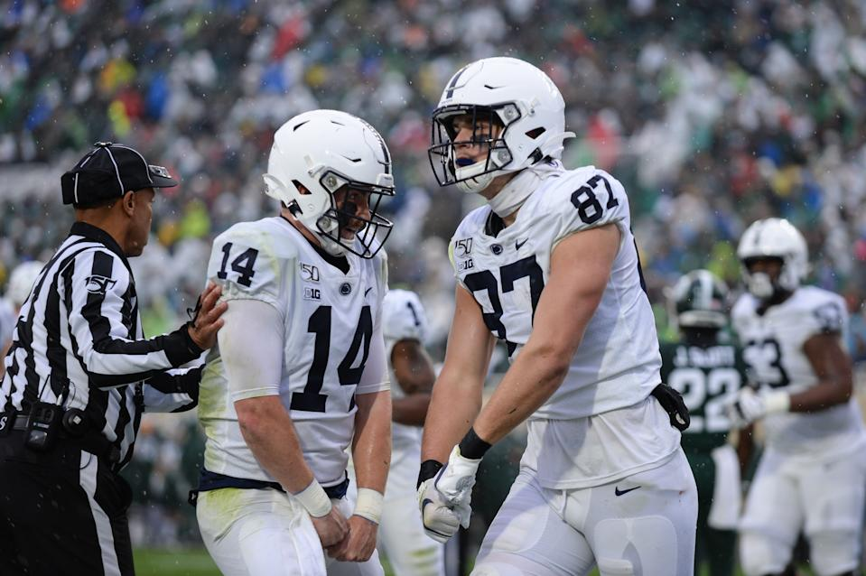 EAST LANSING, MI - OCTOBER 26: Penn State tight end Pat Freiermuth (87) and quarterback Sean Clifford (14) celebrate Freiermuth's second quarter touchdown during a college football game between the Michigan State Spartans and Penn State Nittany Lions on October 26, 2019 at Spartan Stadium in East Lansing, MI. (Photo by Adam Ruff/Icon Sportswire via Getty Images)