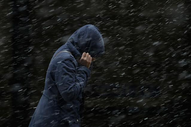 <p>A woman walks through a winter storm, Tuesday, March 20, 2018, in Philadelphia. (Photo: Matt Slocum/AP) </p>