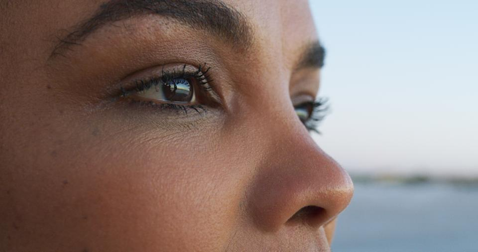 Closeup shot of an attractive young woman taking in all the sights at the beach