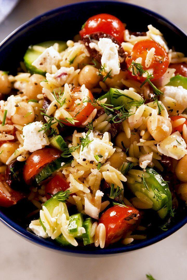 """<p>Though it looks a bit like <a href=""""https://www.delish.com/uk/food-news/a28997170/how-to-cook-rice/"""" rel=""""nofollow noopener"""" target=""""_blank"""" data-ylk=""""slk:rice"""" class=""""link rapid-noclick-resp"""">rice</a>, orzo isn't a grain. It's <a href=""""https://www.delish.com/uk/pasta-recipes/"""" rel=""""nofollow noopener"""" target=""""_blank"""" data-ylk=""""slk:pasta"""" class=""""link rapid-noclick-resp"""">pasta</a>! This easy make-ahead salad is filled with all your favourite bright <a href=""""https://www.delish.com/uk/cooking/recipes/a29843193/mediterranean-chickpea-salad-recipe/"""" rel=""""nofollow noopener"""" target=""""_blank"""" data-ylk=""""slk:Mediterranean"""" class=""""link rapid-noclick-resp"""">Mediterranean</a> flavours and mix-ins, like tomatoes, olives, and cucumbers. Don't skip the homemade lemon-and-dill dressing—it's SO much better than anything you can buy in a bottle! </p><p>Get the <a href=""""https://www.delish.com/uk/cooking/recipes/a32157065/greek-orzo-pasta-salad-recipe/"""" rel=""""nofollow noopener"""" target=""""_blank"""" data-ylk=""""slk:Greek Orzo Pasta Salad"""" class=""""link rapid-noclick-resp"""">Greek Orzo Pasta Salad</a> recipe.</p>"""