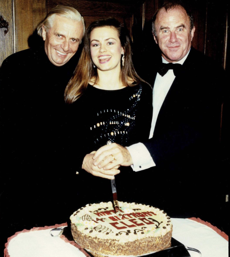 Lisa Wilkinson with Barry Humphries and Clive James cutting a cake at CLEO magazine's 14th birthday party in 1986.