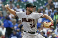 Arizona Diamondbacks starting pitcher Merrill Kelly throws against the Chicago Cubs during the first inning of a baseball game in Chicago, Saturday, July 24, 2021. (AP Photo/Nam Y. Huh)