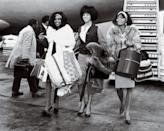 <p>At the height of their fame, the glam trio (from left: Mary Wilson, Florence Ballard and Diana Ross) arrived at London's Heathrow Airport dressed to impress.</p>