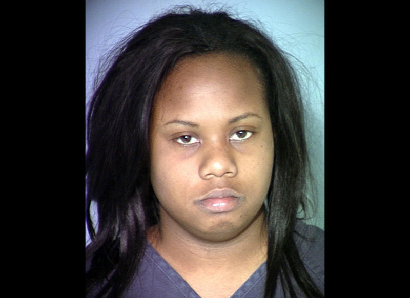 This image provided by the Las Vegas Metropolitan Police Department shows Danielle Yvonne Slaughter, who is accused of stabbing her 6-year-old daughter to death with scissors. Slaughter, who was arrrested March 11, 2012, told police she had been taking a weight-loss product, had trouble sleeping for several days and felt an evil presence before the attack.(AP Photo/LVMPD)
