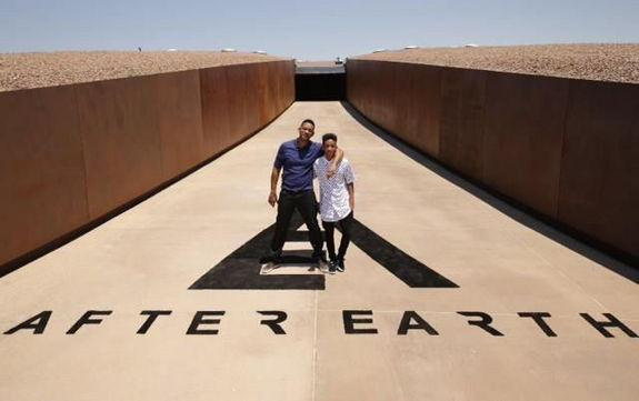 """After Earth"" stars Will and Jaden Smith pose for a photo at New Mexico's Spaceport America during the press junket for their science fiction film on May 17, 2013."