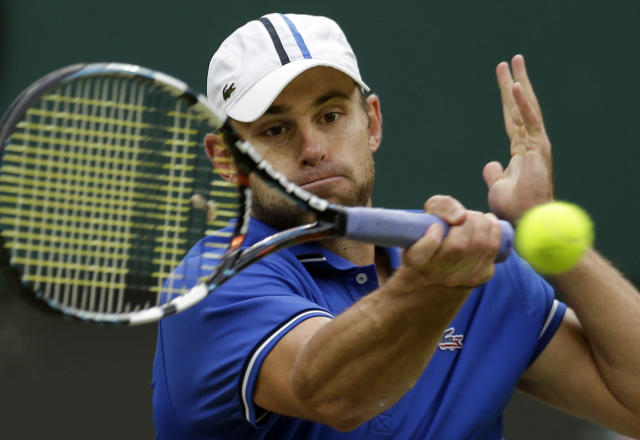 Andy Roddick of the United States returns to Novak Djokovic of Serbia at the All England Lawn Tennis Club in Wimbledon, London at the 2012 Summer Olympics, Tuesday, July 31, 2012. (AP Photo/Elise Amendola)