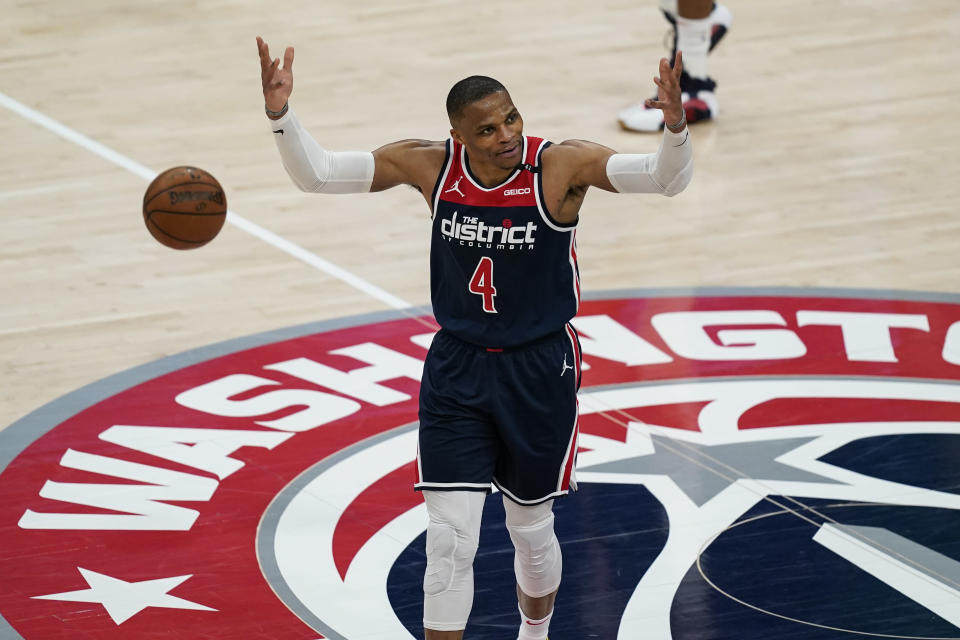 Washington Wizards guard Russell Westbrook reacts with the fans during a timeout during the second half of a basketball game against the Indiana Pacers, Monday, May 3, 2021, in Washington. (AP Photo/Alex Brandon)