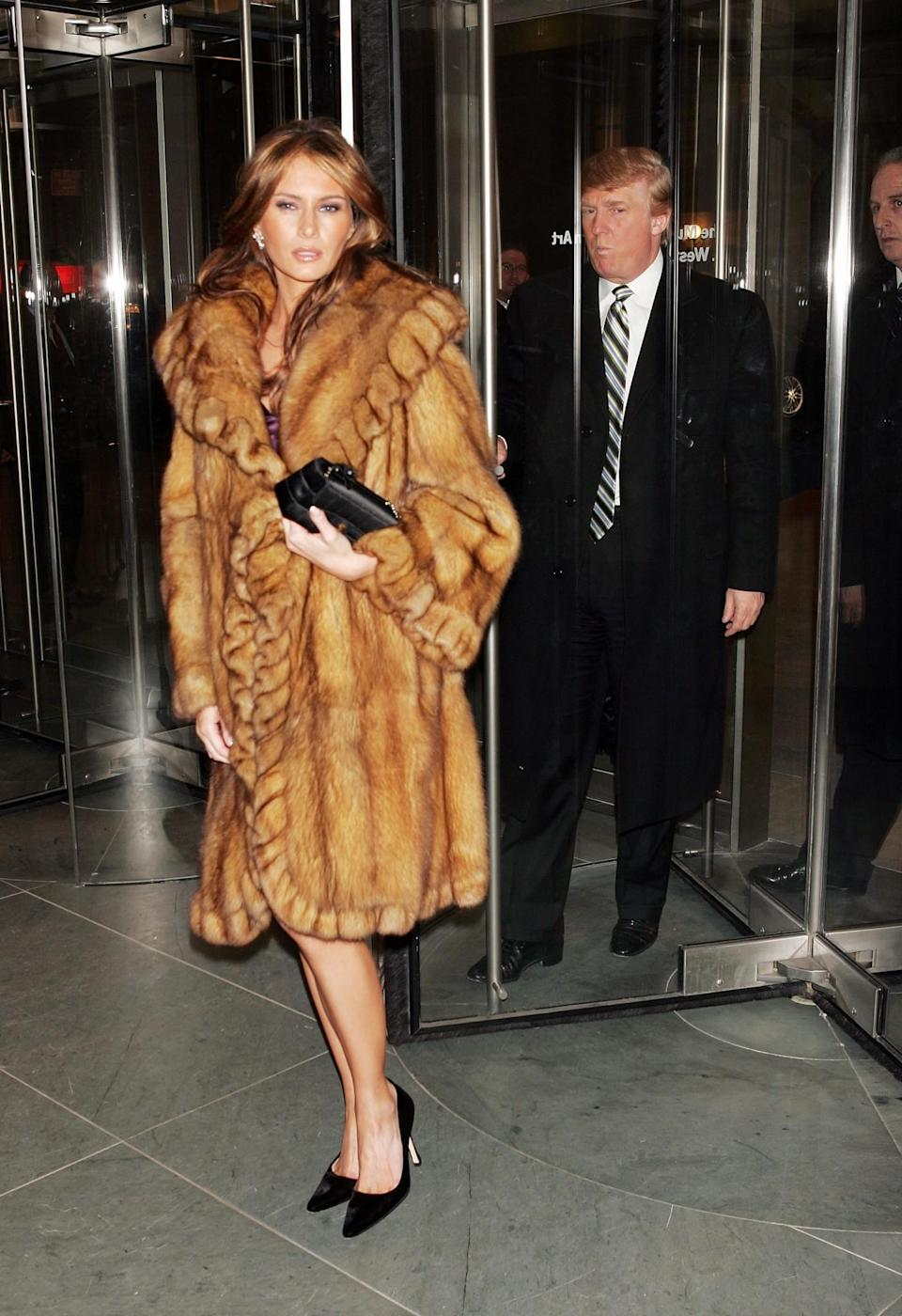 <p>Melania was spotted leaving a hotel in a luxe (and extremely expensive) fur coat paired with simple black heels. <i>[Photo: Getty]</i> </p>