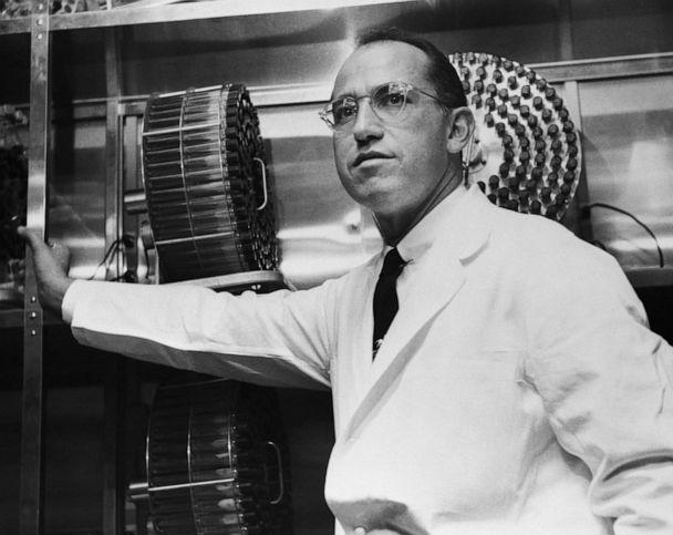 PHOTO: Dr. Jonas Salk stands in the University of Pittsburgh laboratory in which he developed a vaccine for polio. (Getty Images)