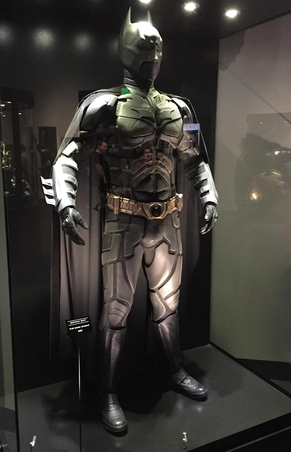 <p>Christian Bale's Caped Crusader get-up is displayed in the studio's interactive Warner Bros. Experience, which features props, storyboards, models, scripts, and mo-cap exhibits.</p>