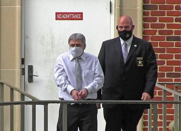 PHOTO: Roddy Bryant, accused in the shooting death of Ahmaud Arbery, is led by security officers from the Glynn County Courthouse in Brunswick, Ga., May 12, 2021, in this image from video.  (Lewis M. Levine/AP)