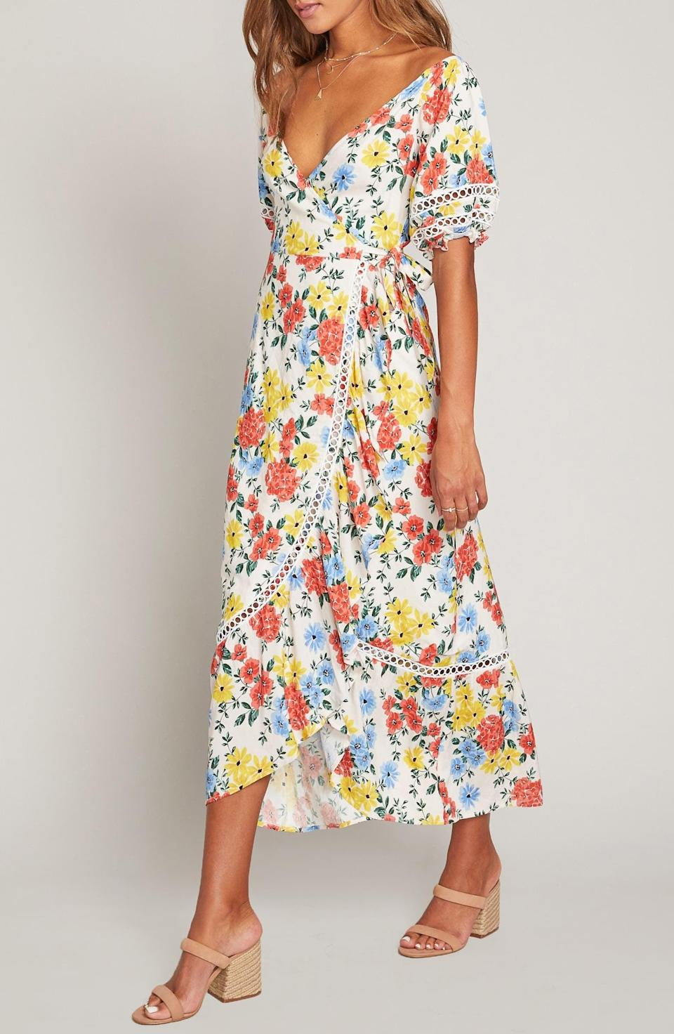 <p>This <span>Lost + Wander Center of Attention Floral Wrap Dress</span> ($125) makes me want to go on a vacation.</p>