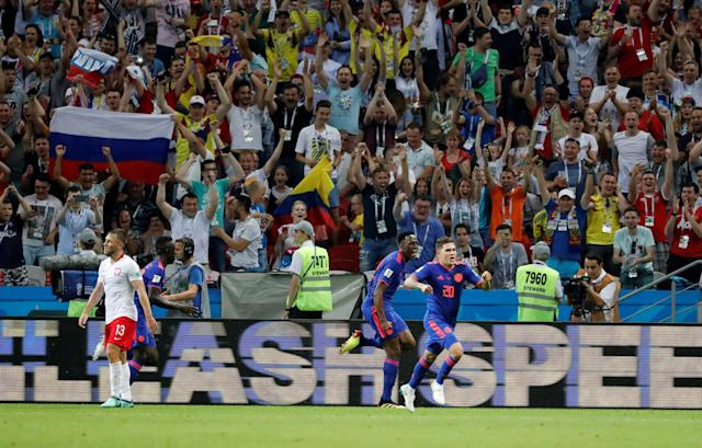 Soccer Football - World Cup - Group H - Poland vs Colombia - Kazan Arena, Kazan, Russia - June 24, 2018 Colombia's Yerry Mina celebrates scoring their first goal with Davinson Sanchez and Juan Fernando Quintero REUTERS/Toru Hanai