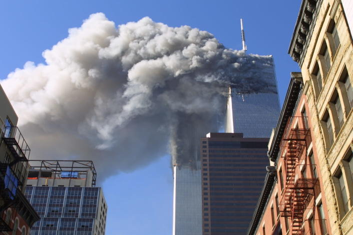 FILE - In this Sept. 11, 2001 file photo, the twin towers of the World Trade Center burn after hijacked planes crashed into them in New York as part of a plot by al-Qaida leader Osama bin Laden. Years after the death of his father at the hands of a U.S. Navy SEAL raid in Pakistan, Hamza bin Laden himself clearly in the crosshairs of world powers. The U.S. has put up to a $1 million bounty for him. The U.N. Security Council has named him to a global sanctions list, sparking a new Interpol notice for his arrest. His home country of Saudi Arabia has revoked his citizenship. (AP Photo/Diane Bondareff, File)