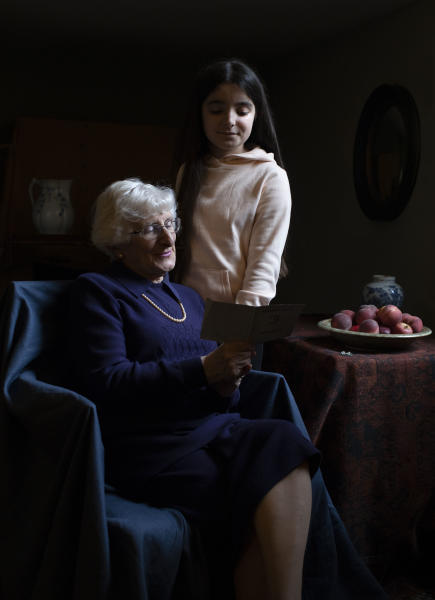 In this photo taken by Britain's Kate, Duchess of Cambridge and made available on Sunday Jan. 26, 2020, Yvonne Bernstein, originally from Germany, who was a hidden child in France throughout most of the Holocaust, pictured with her granddaughter Chloe Wright, aged 11. (The Duchess of Cambridge via AP)