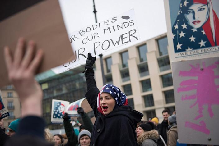 <p>A woman wearing a USA flag as a headscarf attends a protest for women's rights and freedom in solidarity with the Women's March on Washington in front of Brandenburger Tor on January 21, 2017 in Berlin, Germany. (Steffi Loos/Getty Images) </p>