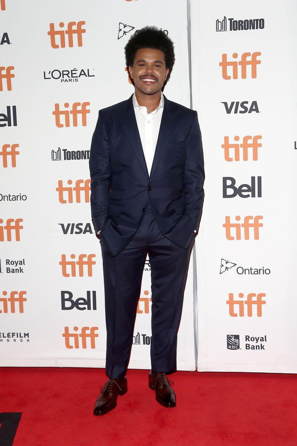 <p>Of course, no man can wear one color all the damn time. (Even Johnny Cash occasionally ventured out of the darkness to throw on a crisp white shirt.) But when Tesfaye strays from his typical all-black fits, he still keeps it largely monochromatic, as he did at the TIFF<em> Uncut Gems</em> premiere here. </p>