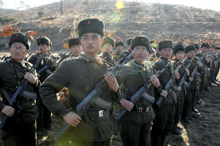 North Korean members of the Worker-Peasant Red Guards attend military training. REUTERS/KCNA