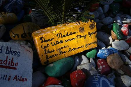 A get-well message is seen on a brick outside former South African president Nelson Mandela's garden in Houghton, Johannesburg August 31, 2013.