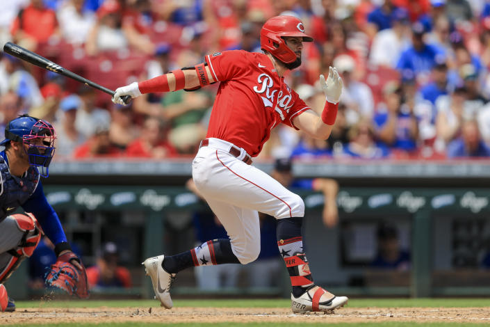 Cincinnati Reds' Jesse Winker watches as he grounds into an RBI-force out during the seventh inning of a baseball game against the Chicago Cubs in Cincinnati, Sunday, July 4, 2021. (AP Photo/Aaron Doster)