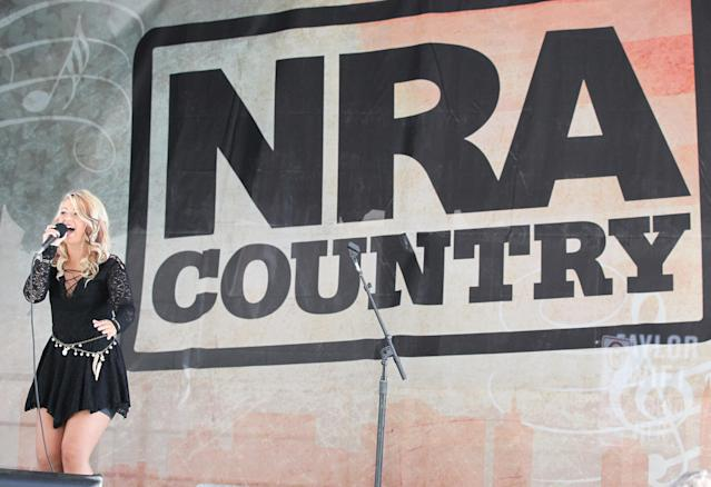 Abbi Scott performs at the NRA 2015 annual meeting on April 12, 2015, in Nashville, Tenn. (Photo: Terry Wyatt/Getty Images)