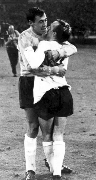 FILE - In this July 26, 1966 file photo England's goalkeeper Gordon Banks, left, hugs midfielder Nobby Stiles after the World Cup semi-final soccer match played at Wembley, London. English soccer club Stoke said Tuesday Feb. 12, 2019 that World Cup-winning England goalkeeper Gordon Banks has died at 81. (AP Photo/Bippa, File)