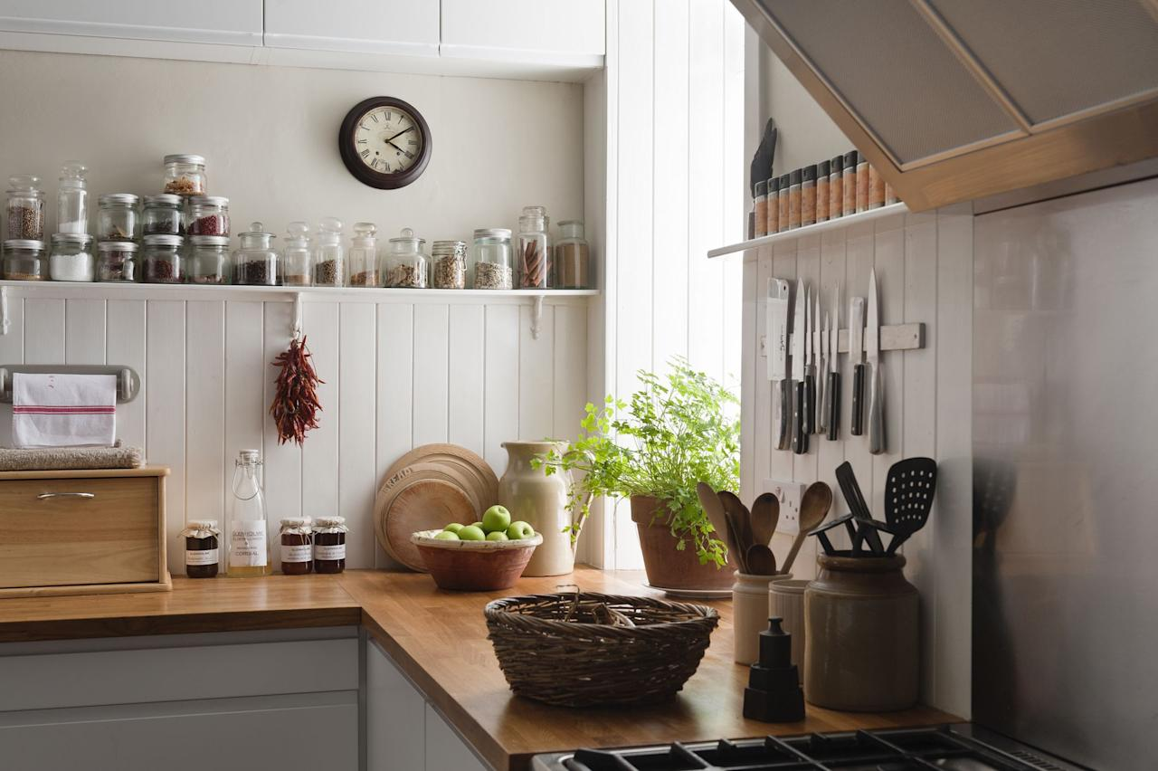 "<p>Every room in your house deserves a splash of greenery, from <a href=""https://www.countryliving.com/gardening/garden-ideas/g26829528/bedroom-plants/"">bedroom plants</a> to <a href=""https://www.countryliving.com/gardening/g29873679/bathroom-shower-plant-ideas/"">bathroom plants</a>. Whether you opt for adorable <a href=""https://www.countryliving.com/gardening/garden-ideas/a29674748/dolphin-succulent-care/"" target=""_blank"">succulent plants</a>, <a href=""https://www.countryliving.com/gardening/garden-ideas/a26265781/cactus-garden/"" target=""_blank"">cactus gardens</a>, or <a href=""https://www.countryliving.com/gardening/g26753835/indoor-trees/"" target=""_blank"">indoor trees</a>, you'll find something to suit your taste. But don't forget your kitchen! You spend tons of time there, so why not surround yourself with the calming effects of nature with kitchen plants? Plants can purify the air too; a now-famous <a href=""https://ntrs.nasa.gov/archive/nasa/casi.ntrs.nasa.gov/19930073077.pdf"" target=""_blank"">1989 NASA study</a> found that houseplants can reduce indoor air pollutants, such as formaldehyde and benzene. Other more recent studies show that <a href=""http://www.exeter.ac.uk/news/research/title_306119_en.html"" target=""_blank"">plants boost creativity</a>, which is perfect when you're trying out that new recipe!</p><p>A south-facing window is best for plants that like bright light, but east- and west-facing windows work too, though the light is less intense. But even if your kitchen doesn't have sunny windows, many plants tolerate low light conditions. And if your kitchen has zero windows, consider mounting LED grow lights under cabinets to provide supplemental light for small potted plants. LEDs don't emit heat like old-school incandescent or halogen bulbs, so you add light without heating up your workspace. Here are a few of the best kitchen plants to bring the outdoors in—not to mention act as an easy <a href=""https://www.countryliving.com/home-design/decorating-ideas/g1213/kitchen-designs/"">kitchen decor idea</a>. </p>"