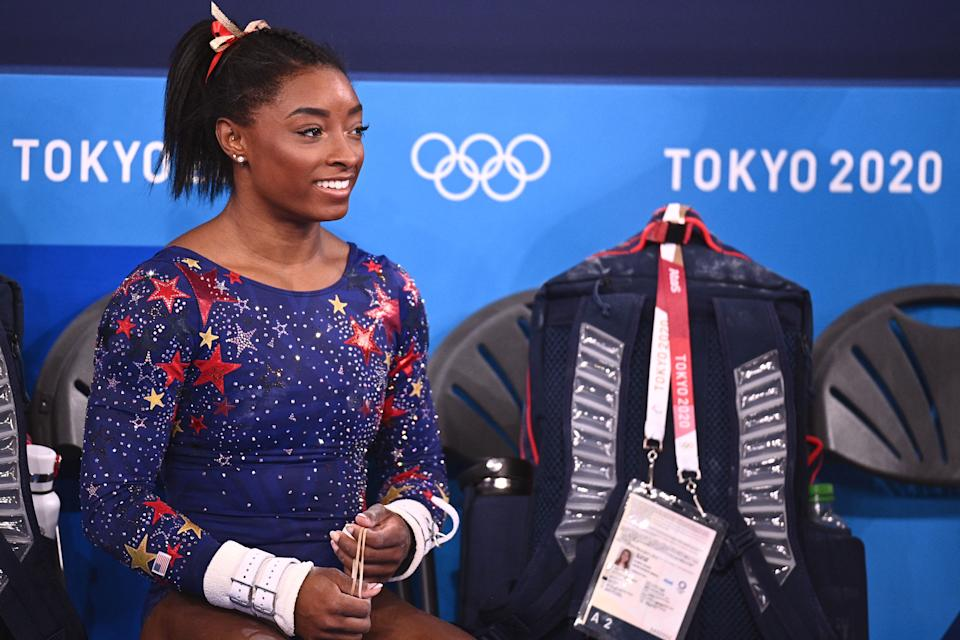 <p>USA's Simone Biles is seen during the artistic gymnastic women's qualification during the Tokyo 2020 Olympic Games at the Ariake Gymnastics Centre in Tokyo on July 25, 2021. (Photo by Martin BUREAU / AFP) (Photo by MARTIN BUREAU/AFP via Getty Images)</p>