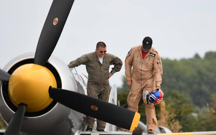 Dave Unwin, 59, and test pilot Eskil Amdal had just performed a loop in a 1951 Hawker Sea Fury when the engine suddenly cut out at 2,000ft - SWNS